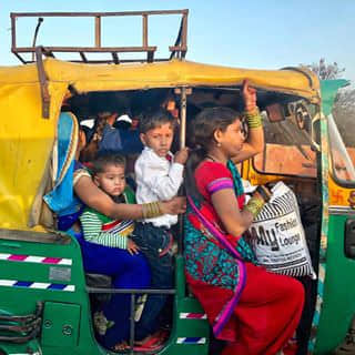 Tuk Tuk, the most convenient vehicle in India. See how many people inside?