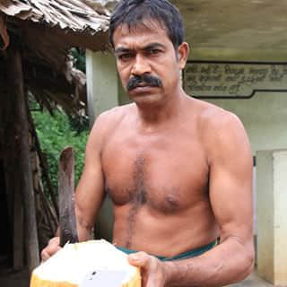 Man with coconut